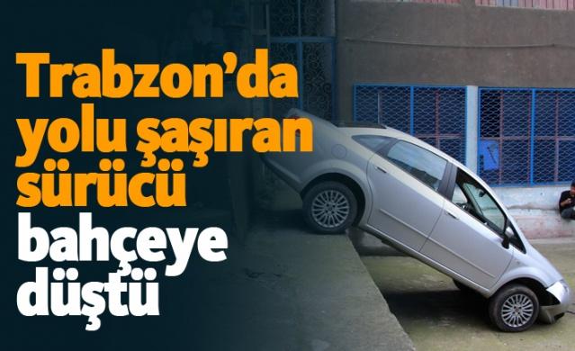 Trabzon'da yolu şaşıran sürücü, yaklaşık 3 metre yükseklikteki duvardan bahçeye düşerken olayda şans eseri ölen ya da yaralanan olmadı.