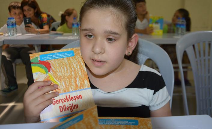 7 yaşında ilk kitabını yazdı
