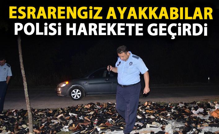 Yol kenarındaki ayakkabılar polisi harekete geçirdi