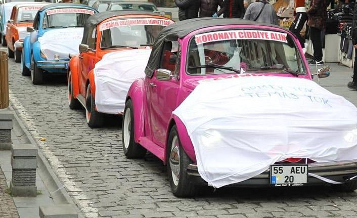 Farkındalık için araçlarına maske taktılar