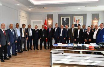 Büyükşehir meclis üyeleri Genç'i ziyaret etti