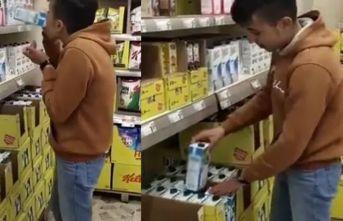Skandal! Markette sütü içti yerine bıraktı!