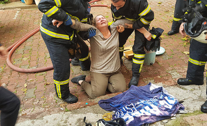 Yangında 3 kedisi ölen kadın sinir krizi geçirdi